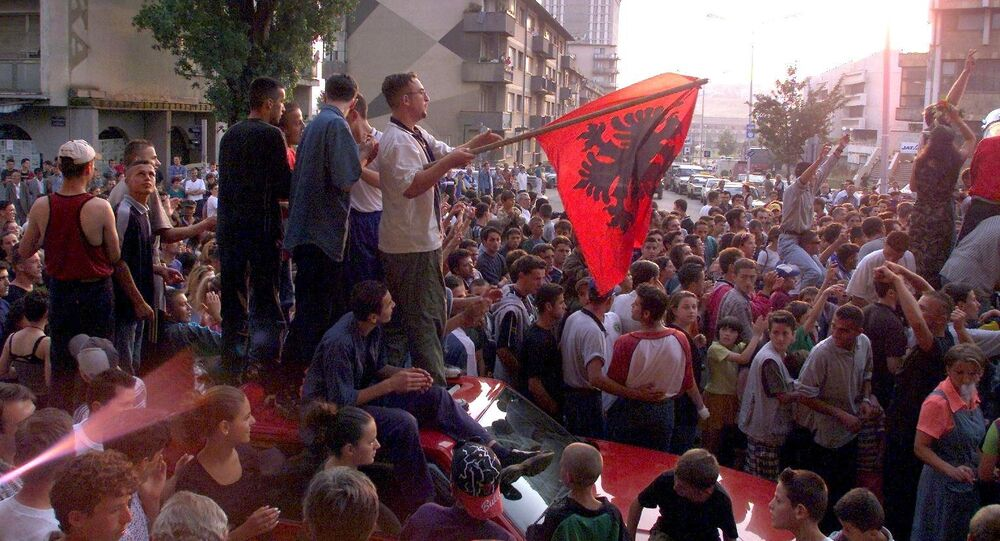 About 1,000 young Kosovar Albanians celebrate the UCK [Kosovo Liberation Army] victory over the Serbs with NATO's help in the centre of Pristina 02 July 1999